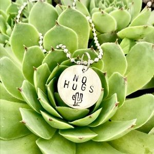Hand stamped metal necklace
